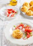 Duchesse potatoes with mushrooms. Baked mashed potatoes with wild mushrooms and vegetables on a white background royalty free stock image