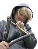 Duck!. Close-up of boy with slingshot Royalty Free Stock Image