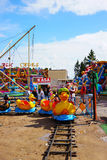 Duck attraction. USTRONIE MORSKIE, POLAND - JULY 20, 2015: People on duck train attraction at a fair Stock Photo