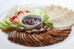 Duck in Beijing with cucumbers and pancakes. Sliced in pieces royalty free stock image
