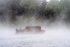 Duck blind in the fog on a small pond Stock Photos