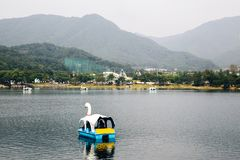 Duck boat on lake with mountain Stock Photos