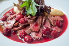 Duck breast with cherry sauce. Stock Photo