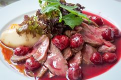 Duck breast with cherry sauce. Royalty Free Stock Photo