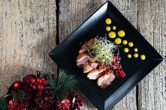 Duck breast, chopped with slices and beautifully presented with cherry sauce stock image