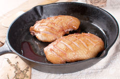 Duck breast with crispy skin frying Stock Photo