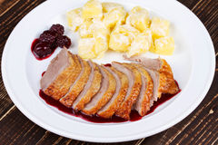 Duck breast fillet with blackberries and wine sauce. Royalty Free Stock Photos