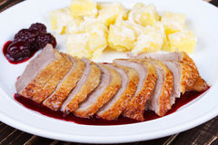 Duck breast fillet with blackberries and wine sauce. Stock Images