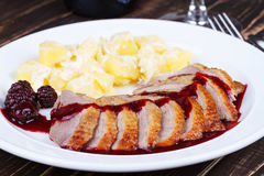 Duck breast fillet with blackberries and wine sauce. Royalty Free Stock Photography