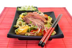 Duck breast with fried noodles Stock Photo