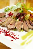 Duck breast with glazed pear and berry sauce Stock Photos