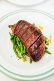 Duck breast with green beans Royalty Free Stock Photos