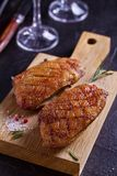 Duck breast, lavender honey and rosemary, served on chopping board. Duck breast, lavender honey and rosemary, served on chopping board royalty free stock photo
