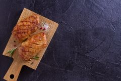 Duck breast, lavender honey and rosemary, served on chopping board. View from above, top studio shot, copy space for text stock images