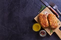 Duck breast, lavender honey and rosemary, served on chopping board. View from above, top studio shot, copy space for text stock photos