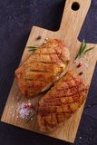 Duck breast, lavender honey and rosemary, served on chopping board. View from above, top studio shot stock images