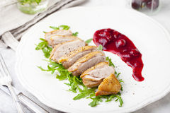 Duck breast meat with fresh salad, arugula and cherry sauce. Royalty Free Stock Photography