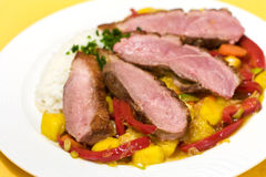 Duck breast with orange mango sauce Stock Photography