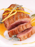 Duck breast and orange sauce Stock Photography