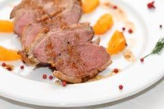 Duck breast in orange sauce. With mandarinovy segments Stock Photos
