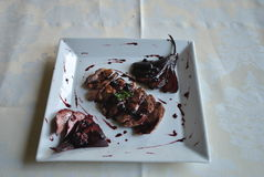 Duck breast with pear in red wine Stock Images