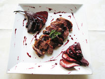 Duck breast with pear in red wine Stock Photos