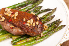 Duck breast with pine nuts and asparagus Royalty Free Stock Photo