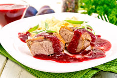 Duck breast with plum sauce and cabbage in plate Stock Images