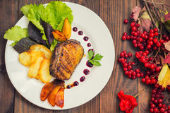 Duck breast with potato chips, herbs, sauce and caramelized apples. Wooden rustic table. Top view. Close-up Stock Photos