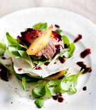 Duck breast roasted with  pear,  salad Stock Photo