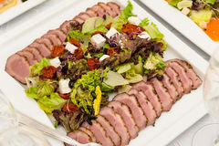 Duck breast salad plate restaurant setting Stock Image