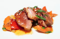 Duck breast with savory sauce. Asian style dish Stock Photos