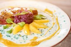 Duck breast served with fresh oranges. Royalty Free Stock Images