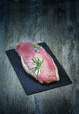 Duck breast. On slate and wooden table stock photos