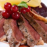 Duck breast in wine sauce Royalty Free Stock Image