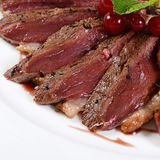 Duck breast in wine sauce Stock Images
