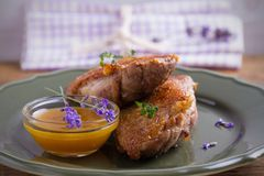 Duck breasts with honey mustard sauce and thyme. Duck breasts with honey mustard sauce and thyme royalty free stock image