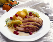 Duck breasts with mixed fruit Stock Image