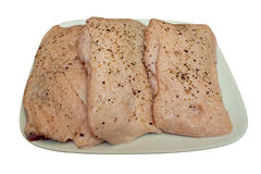 Duck Breasts Raw. Three raw duck breasts seasoned with pepper on an isolated white background Royalty Free Stock Photography