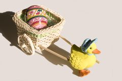 Duck cart with easter egg Stock Photos