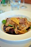 Duck confit. Vertical image of duck confit on a plate Royalty Free Stock Photos