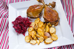 Duck confit with beetroots and jerusalem artichokes fries Royalty Free Stock Image