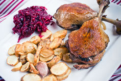 Duck confit with beetroots and jerusalem artichokes fries. Traditional duck legs confit with beetroots and jerusalem artichokes fries Stock Image