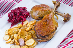 Duck confit with beetroots and jerusalem artichokes fries Stock Photography