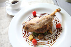 Duck confit , Roasted duck with blueberry sauce Stock Images