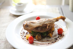 Duck confit , Roasted duck with blueberry sauce Royalty Free Stock Photos
