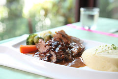 Duck confit , Roasted duck with blueberry sauce Stock Photo