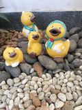 Duck dolls standing on stones at the garden Stock Image