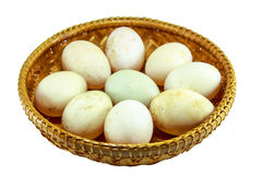 Duck eggs in the bamboo bowl basket on white background Royalty Free Stock Images
