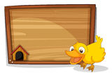 A duck beside an empty wooden board Stock Photo